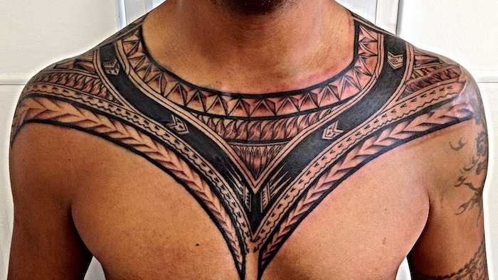 tribal chest tattoo, necklace like, man standing, in front of a white background, simple tattoos for men