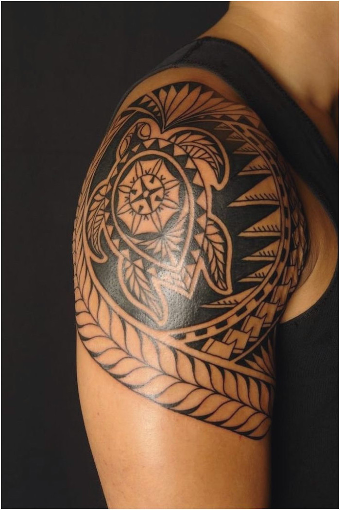tribal turtle, shoulder tattoo, meaningful tattoos, man wearing a black top, standing in front of a black background