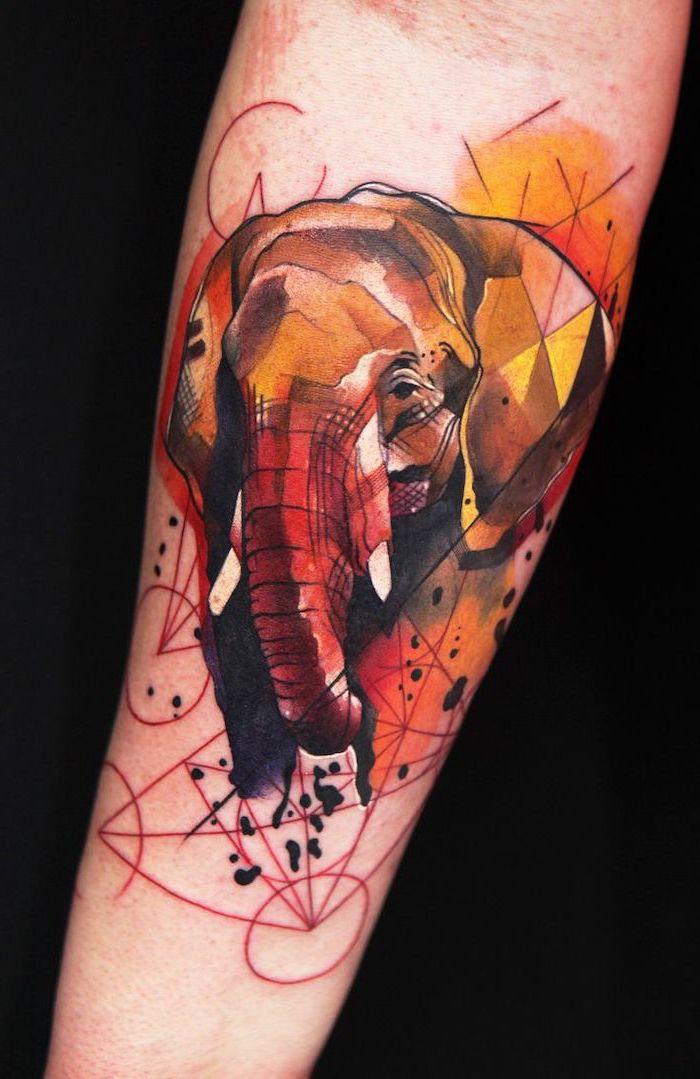 elephant head, watercolour forearm tattoo, small meaningful tattoos, black background