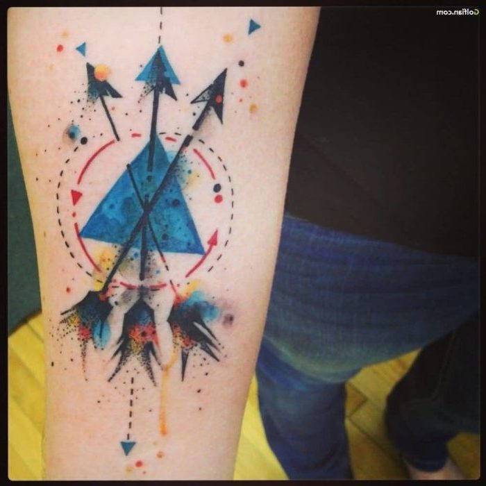 three arrows, geometrical design, watercolour forearm tattoo, tattoo ideas with meaning, man wearing jeans
