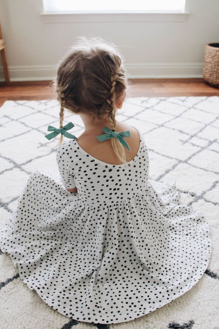 two blue bows, two braids, blonde hair, short hairstyles for little girls, white and black dotted dress