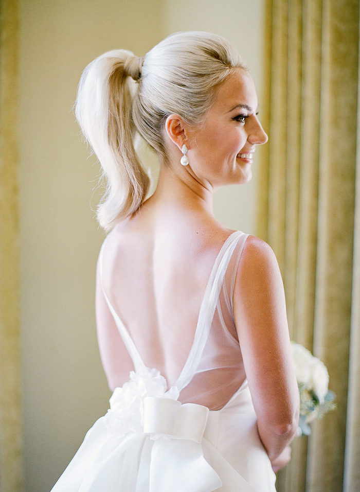 white lace dress, with a large bow, blonde hair, in a high ponytail, easy to do hairstyles