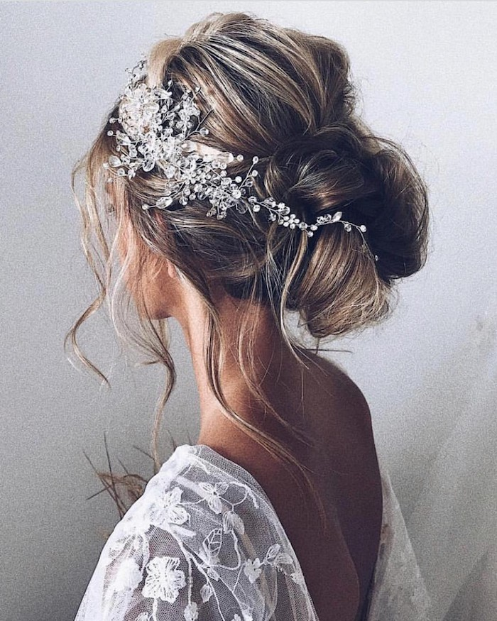 white lace dress, brown hair with highlights, in a low updo, loose updos, large pearl hair accessory