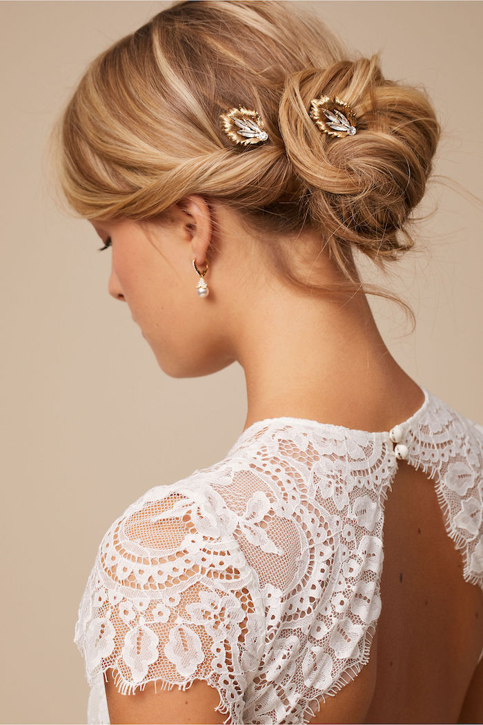 white lace dress, blonde hair in a low updo, small crystal hair accessories, loose updos