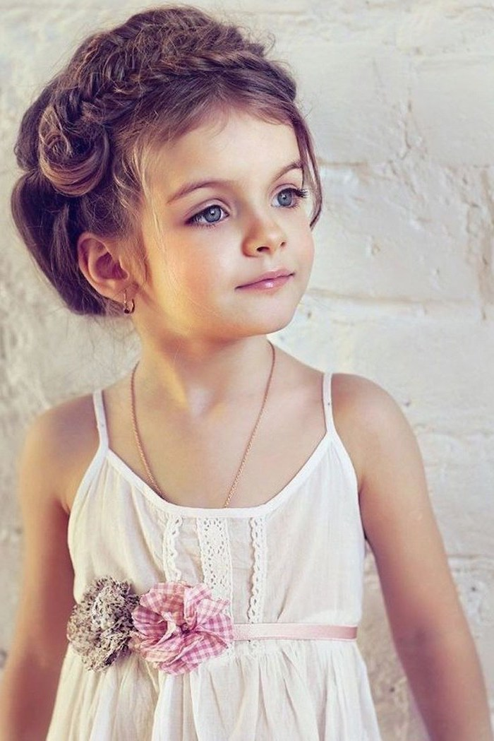 white top, braided brown hair, white background, blue eyes, cool hairstyles for girls