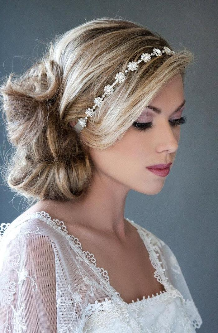 blonde hair with highlights, in a low updo, small headband, loose updos, white lace dress