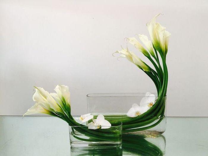 white flowers, in a bathtub like vases, flower art, flower arrangements ideas, on a glass countertop