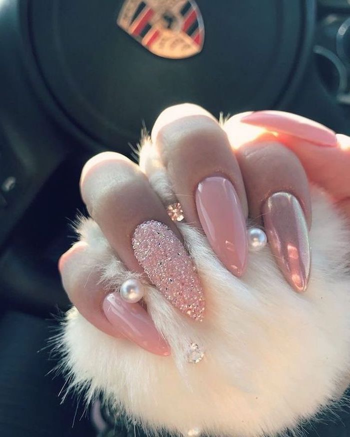 pink nail polish, pink glitter nail polish, long stiletto nails, cute easy nail designs, hand holding a white fur ball