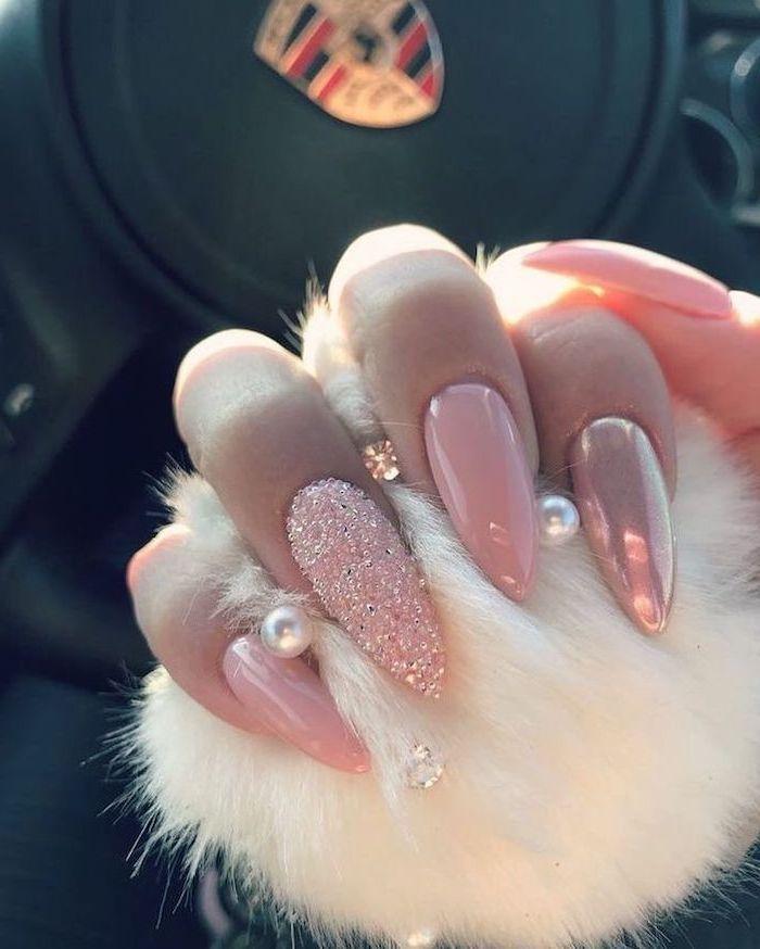 pink nail polish, pink glitter nail polish, long stiletto nails, cute easy nail designs, hand holding a white fur ball