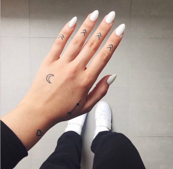 70b10b31d arrows tattoos, on each finger, white nail polish, finger tattoos for  girls, Finger Tattoo: Over 70 cool themes and their meaning ...