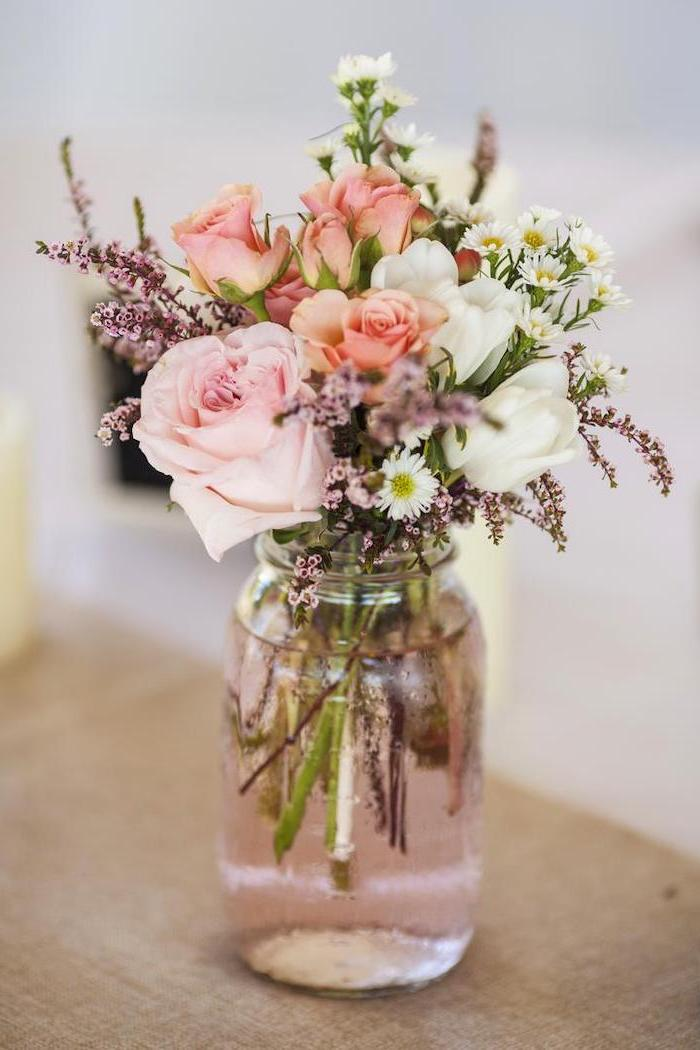 pink and white roses and tulips, small flower bouquet, flower arrangements ideas, in a small jar, on a wooden table