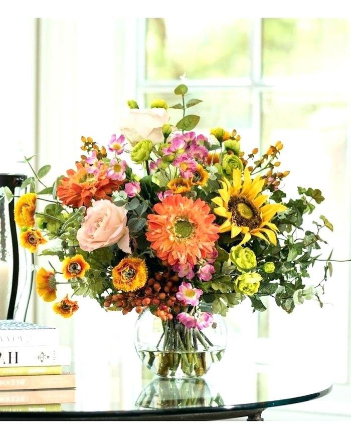 large colourful flower bouquet, in a round glass vase, on a glass table, flower arrangements ideas