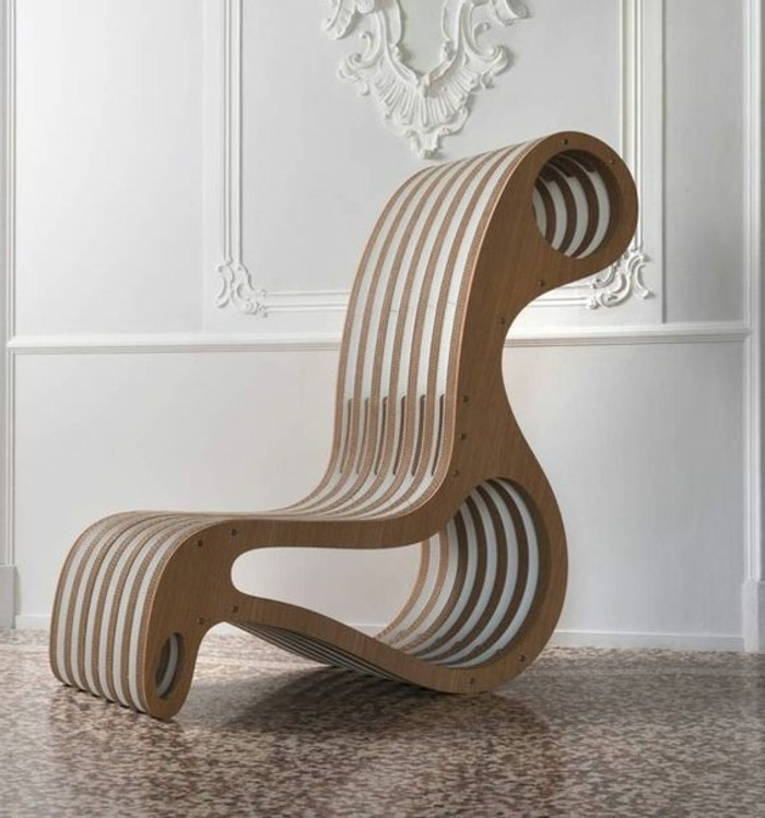 white wall, mosaic floor, intricate design, cardboard armchair, how to make a cardboard chair