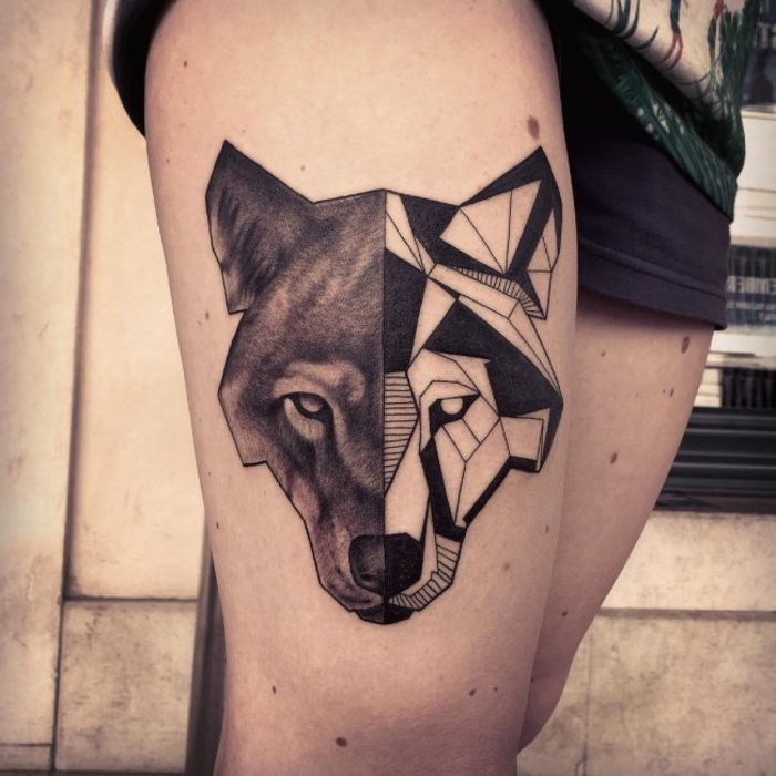 wolf face, half geometrical, half black, geometric owl tattoo, tattoo on a girl's thigh