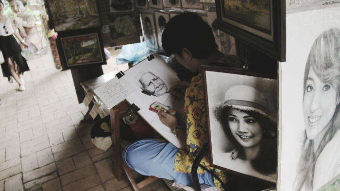woman sitting on a chair, drawing a picture, surrounded by drawings, how to draw a girl easy