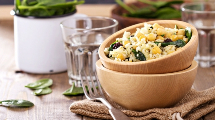 wooden bowls, full of white rice, with corn and basil, healthy meal plans for women, wooden table