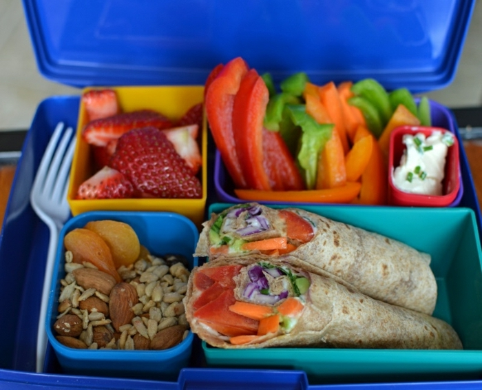 lunch box, full of peppers, strawberries and fruits, tacos with fish, what is a balanced diet