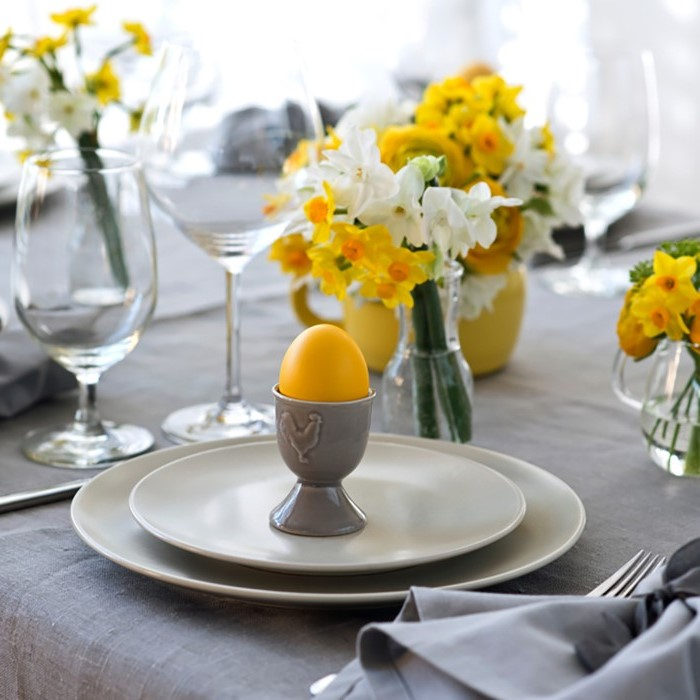dyed yellow egg, small white and yellow flower bouquets, homemade easter decorations