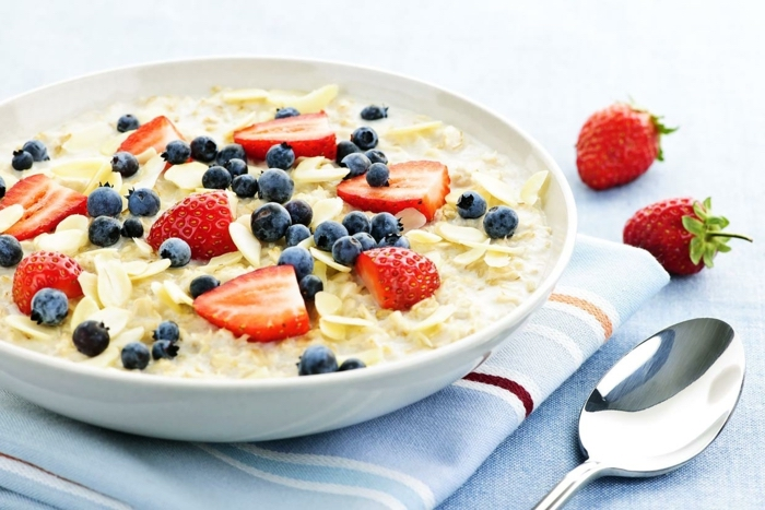 yogurt with oats, with blackberries and strawberries, in a white plate, what is a balanced diet
