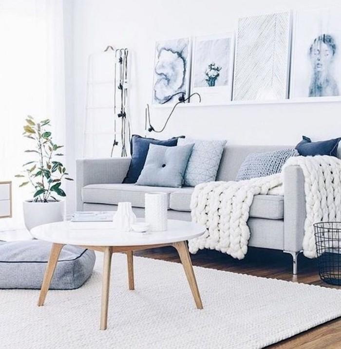 colours that go with grey, grey sofa, white blanket, blue throw pillows, wooden coffee table, white carpet