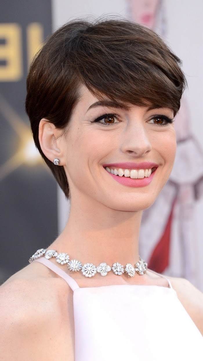 white dress, anne hathaway, brown hair, medium hair cuts for women, diamond flowers necklace