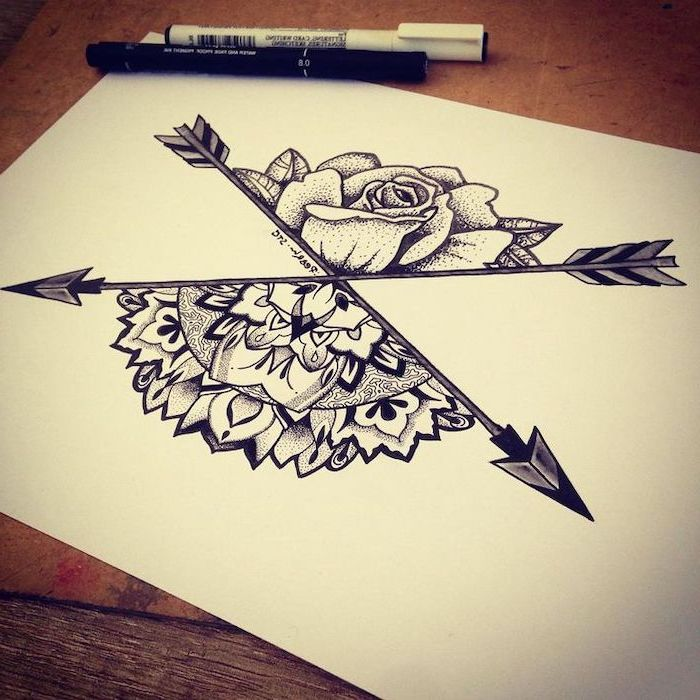 arrows crossing, half rose, mandala tattoo, black white sketch, white background, wooden table