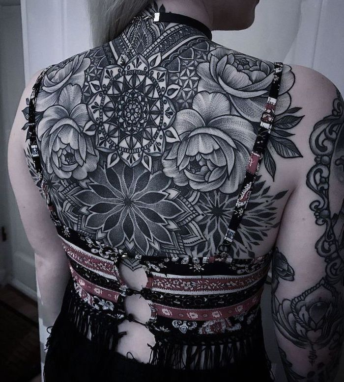 colourful top, whole back tattoo, blonde hair, mandala shoulder tattoo