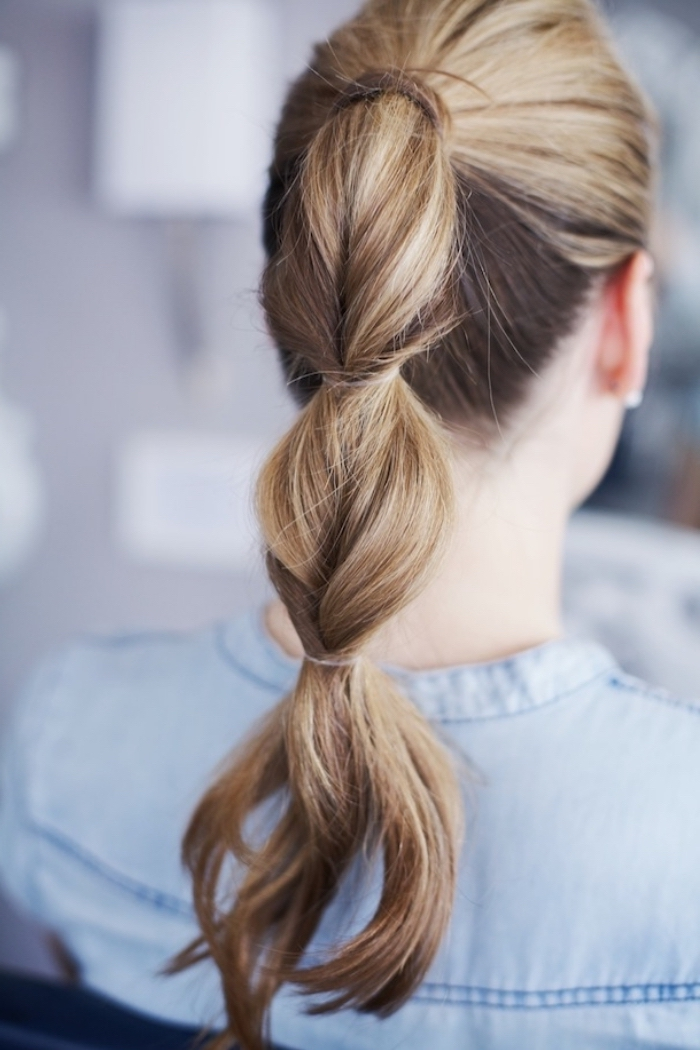 balloon ponytail, long hairstyles for women, light blonde hair, woman wearing a denim shirt