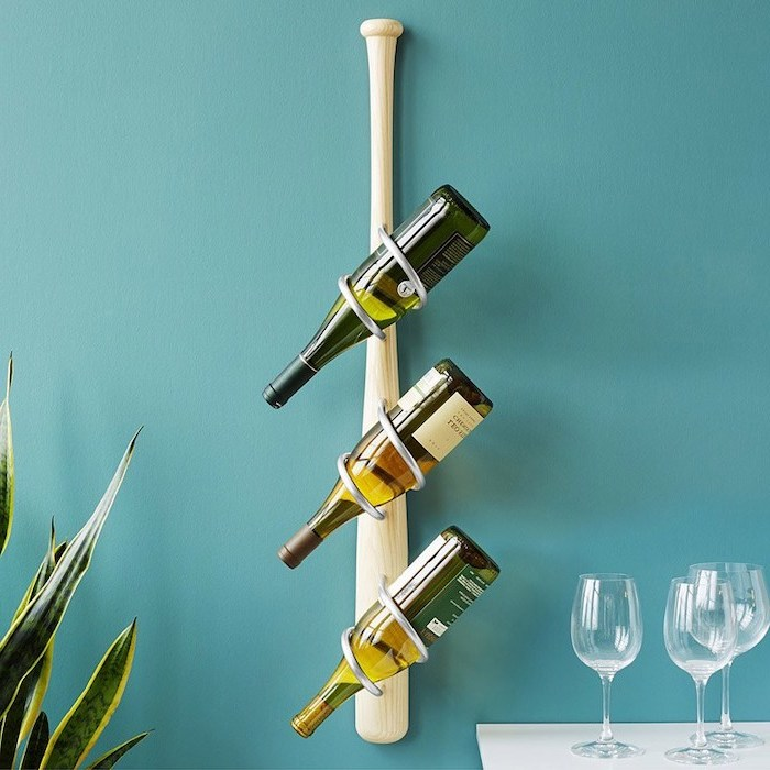 blue wall, baseball bat, wine rack, wine glasses, traditional housewarming gifts