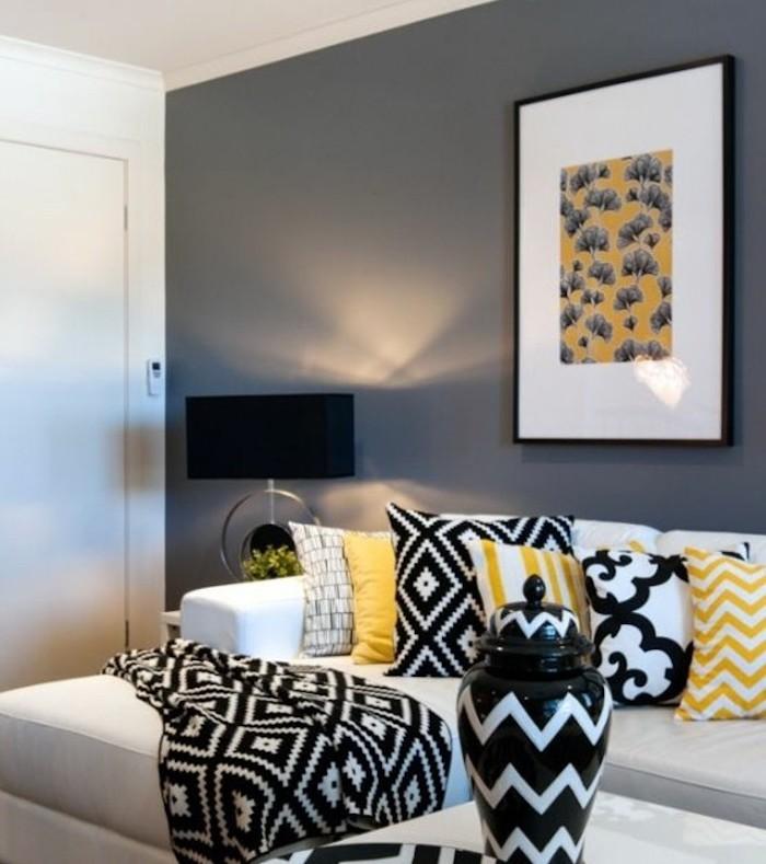 white sofa, grey wall, yellow throw pillows, black blanket, colours that go with grey