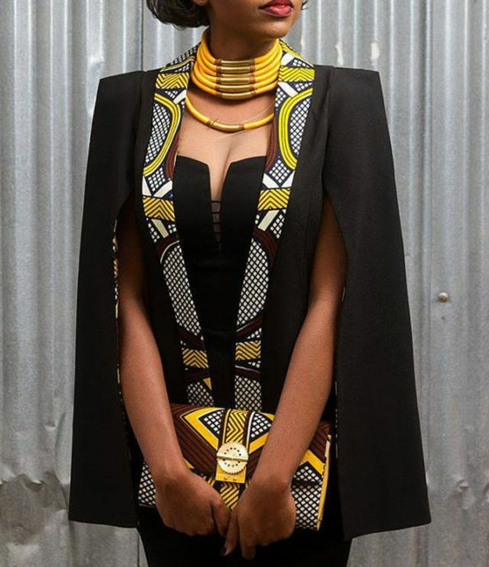 black dress and blazer, large yellow necklace, african attire, patterned clutch bag
