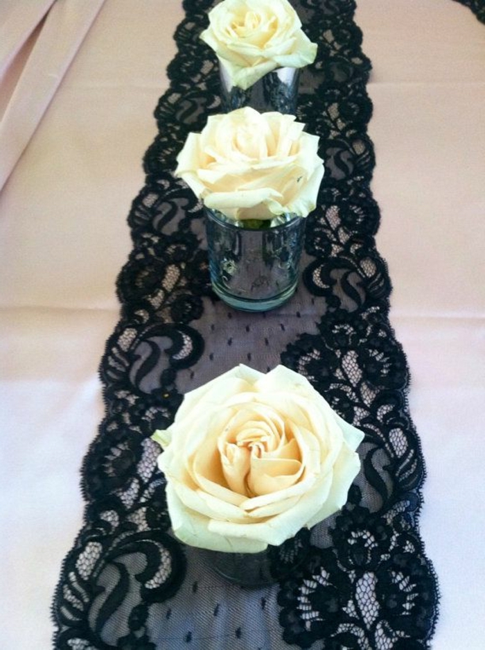 black lace, table runner, table setting images, small glass vases, white rose in each one