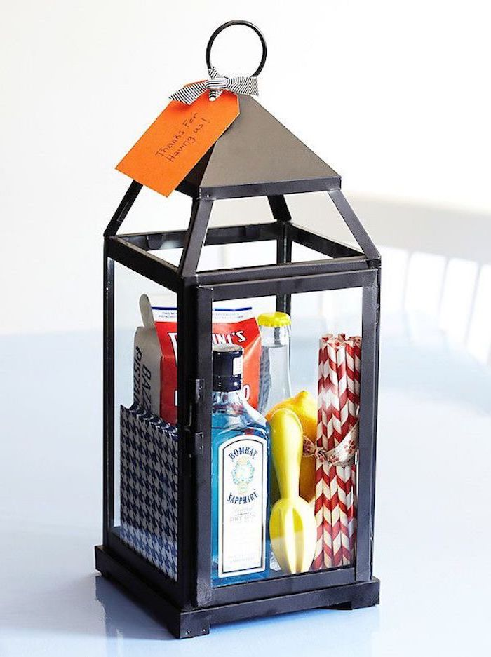 funny housewarming gifts, black metal lantern, filled with straws, gin and tonic