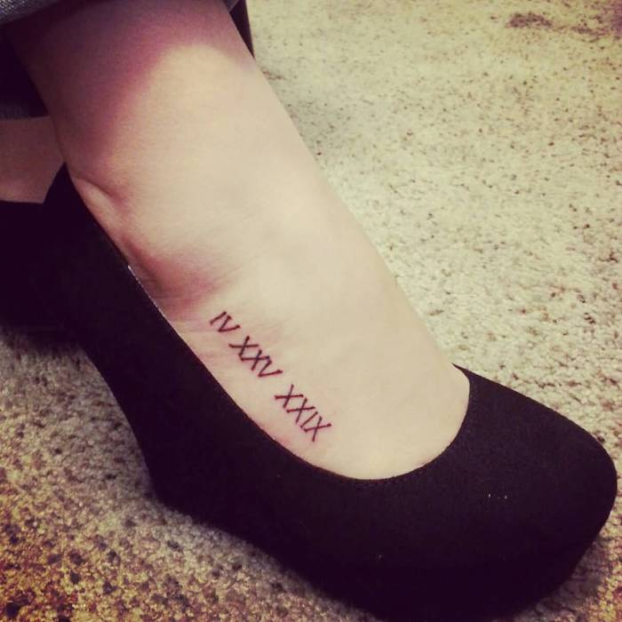 black platform shoes, foot tattoo, birthday in roman numerals