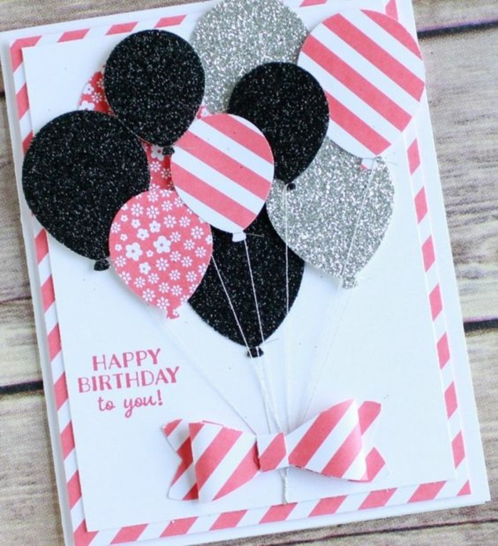 silver and black glitter, pink patterned balloons, pop up birthday cards, white card stock, wooden table