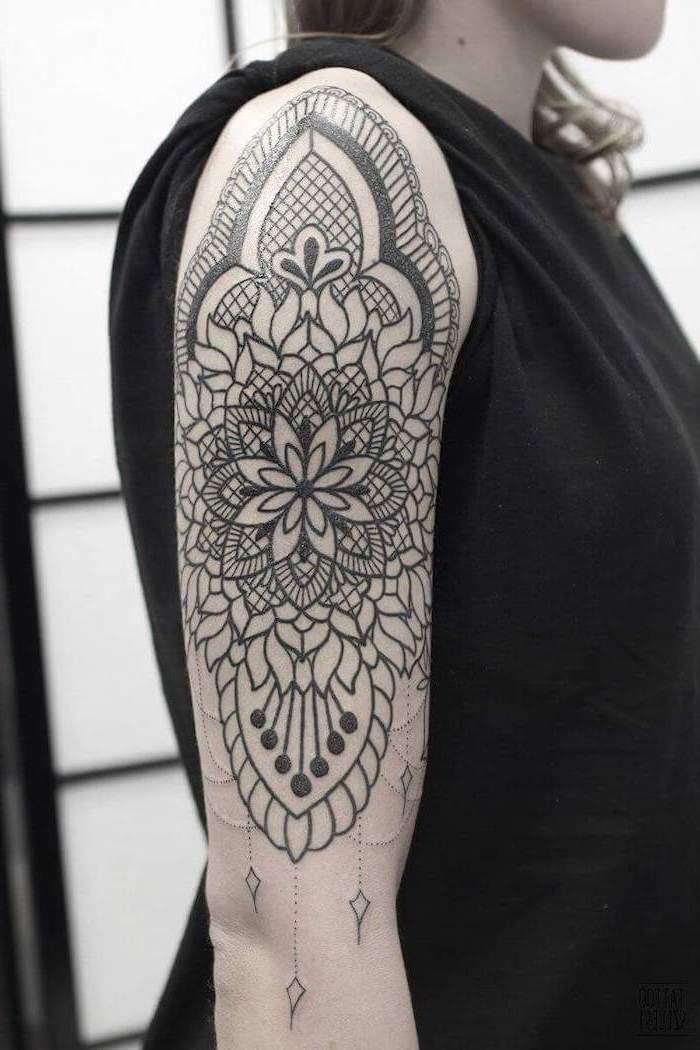 black t shirt, mandala shoulder tattoo, white background, blonde hair