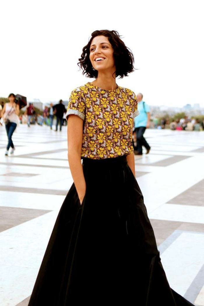 short brown wavy hair, long black velvet skirt, african print fabric, printed crop top