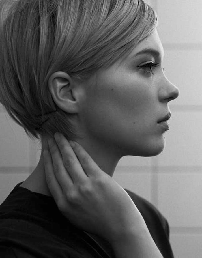 black and white photo, hairstyles for older women, black top, white tiled wall