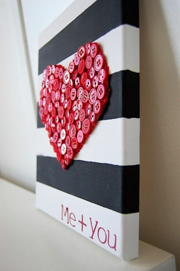 red buttons, forming a heart, unique wall decor, black and white striped, painted canvas, on a white table