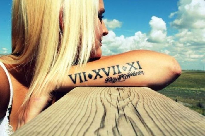 blonde hair, side arm tattoo, birthday tattoos, name and roman numerals