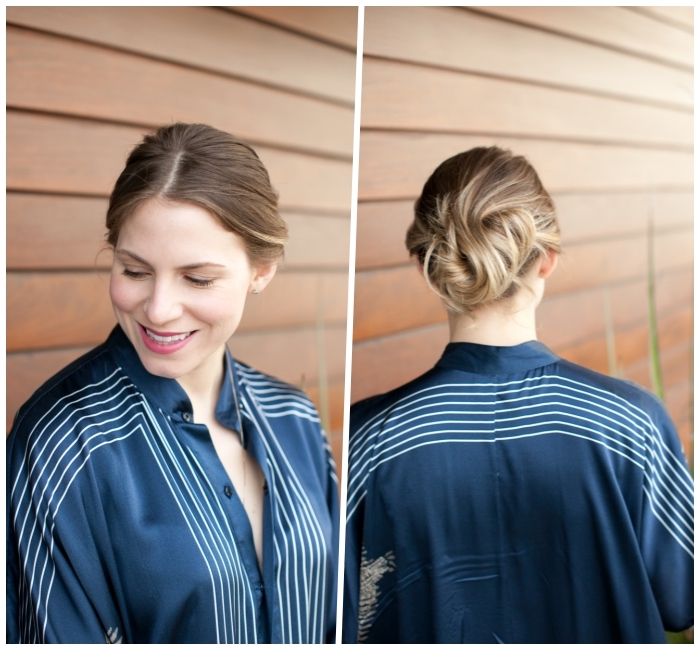 woman wearing a blue satin shirt, easy updos for long hair, light blonde hair, with highlights, in a low updo