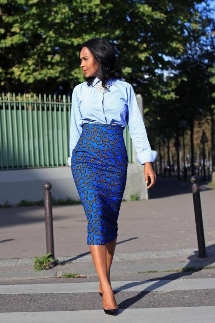 woman walking, wearing a blue shirt, blue skirt, african dresses, black heels, short black hair