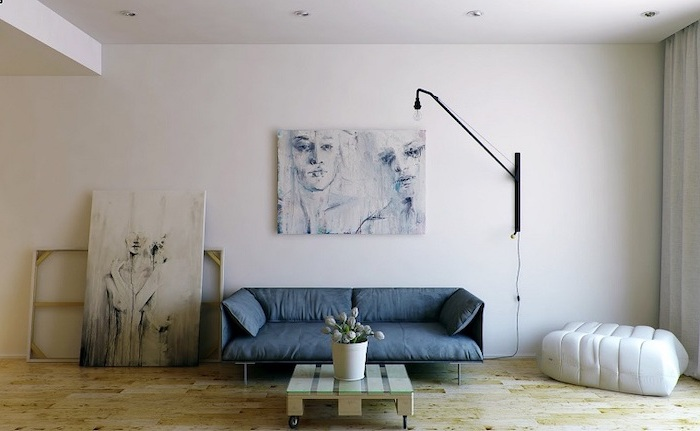 hanging paintings, blue sofa, glass pallet coffee table, white ottoman, wooden floor, room design ideas
