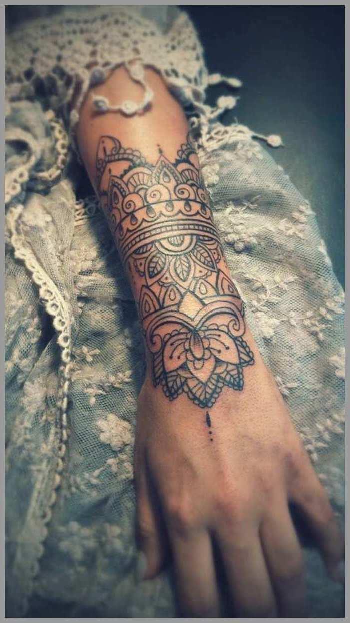 blue and white, lace dress, arm tattoo, mandala tattoo meaning