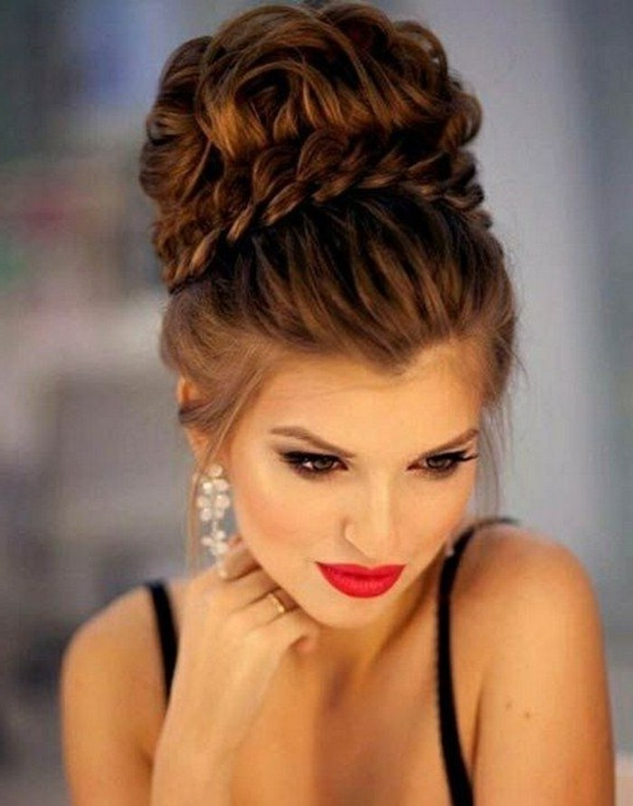 brown hair, in a high messy updo, floral hanging earrings, braid hairstyles for long hair, black straps