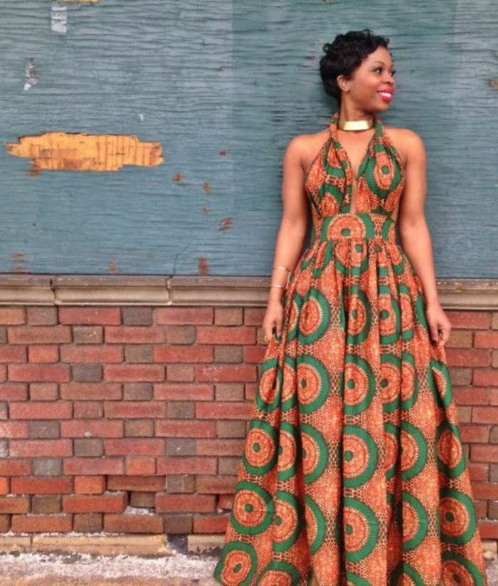 long dress, african print fabric, short curly hair, brick wall, golden necklace