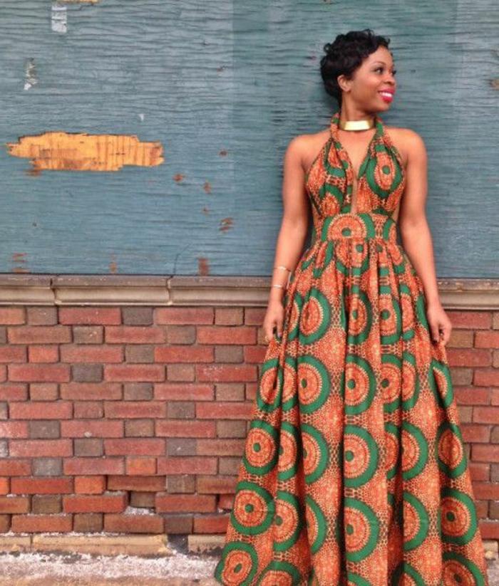long dress, african print fabric, short curly hair, brick wall, golden necklace