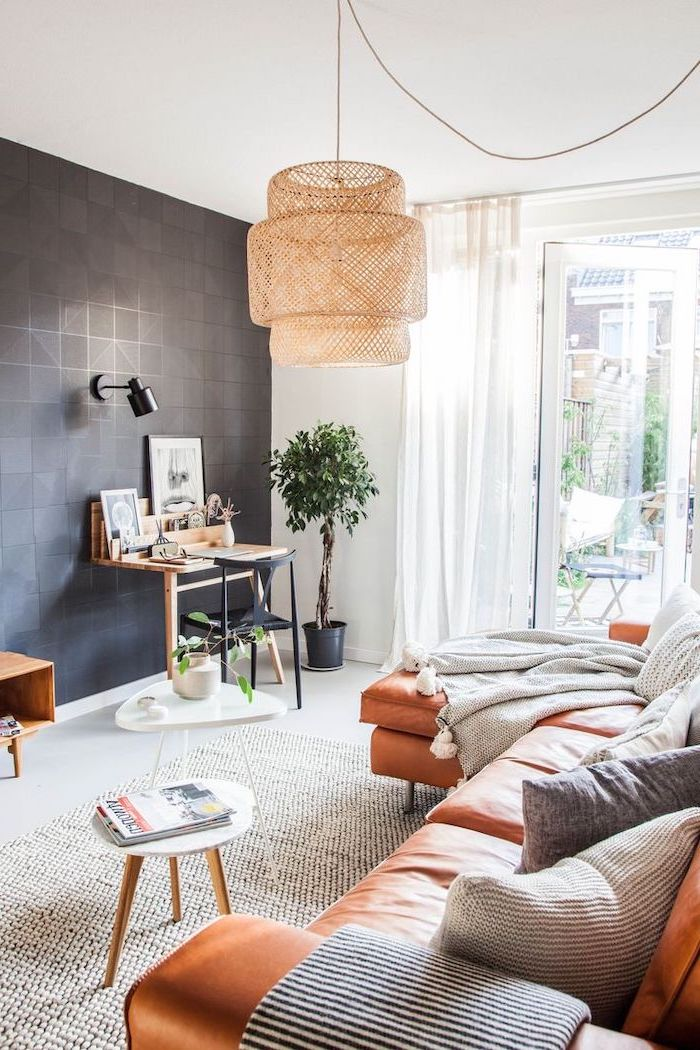 brown leather corner sofa, black tiled wall, how to decorate a living room, small wooden coffee table