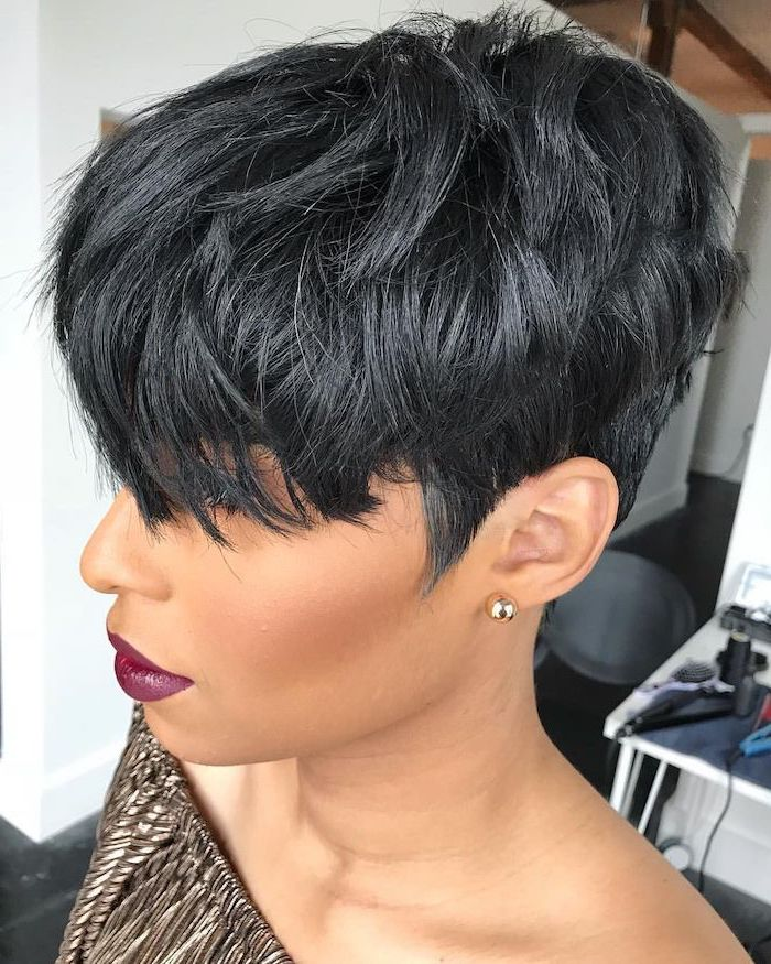 black hair, short haircuts for older women, gold pleated top, gold earrings