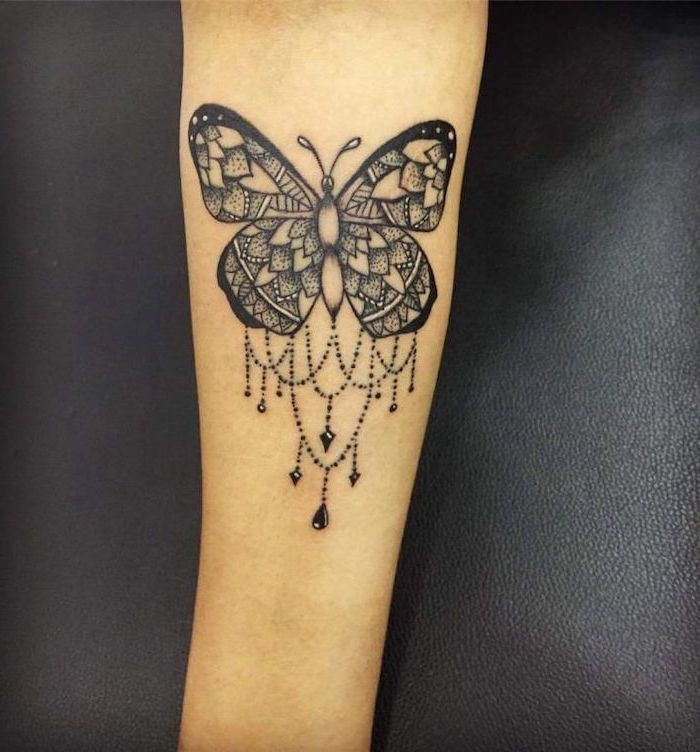 butterfly forearm tattoo, lotus mandala tattoo, black leather background